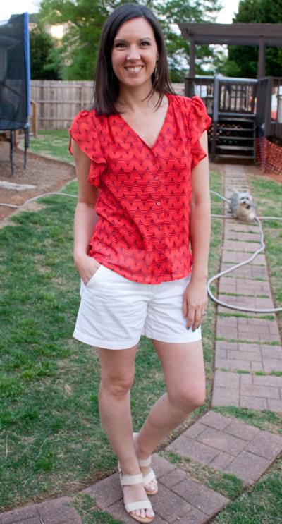 red shirt white shorts